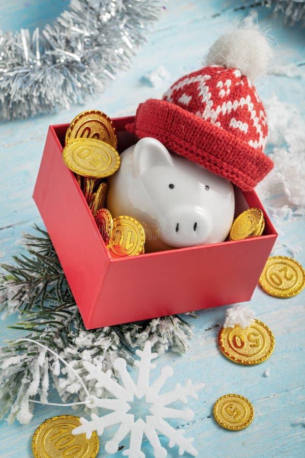 Hucha de la Navidad en caja fotografía de archivo libre de regalías