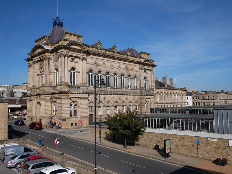 Huddersfield Town hall and indoor market below stock photography