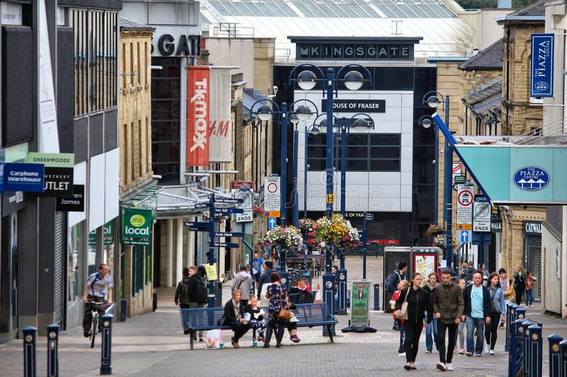 Huddersfield, UK. JULY 10, 2016: People visit shopping area in Huddersfield, West Yorkshire, UK. Huddersfield is the 11th largest town in the UK with a stock photography