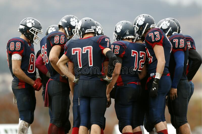 Huddle of American football players
