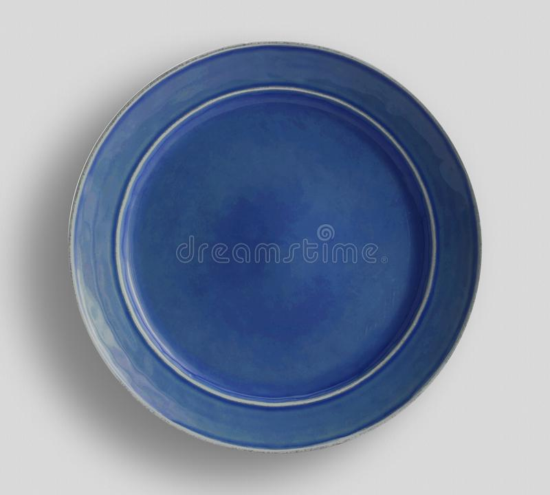 Hue Navy Blue Dinner Plate - Image, Blue shiny button,  design. - VectorDecorative paint on white background, top view - Ima royalty free stock photography
