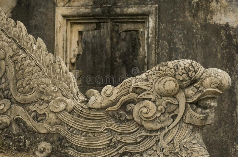 Hue, Thua Thien-Hue, Vietnam - February 26, 2011: Detail of carved stone ladder. Detail of carved stone ladder with dragon figure in the Forbidden Purple City stock photos