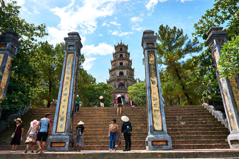 HUE, VIETNAM - JUNE 20, 2019 - People visit he Thien Mu Pagoda in the former Vietnamese capital of Hue royalty free stock photo