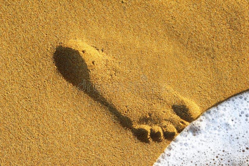 Huella de la arena imagen de archivo