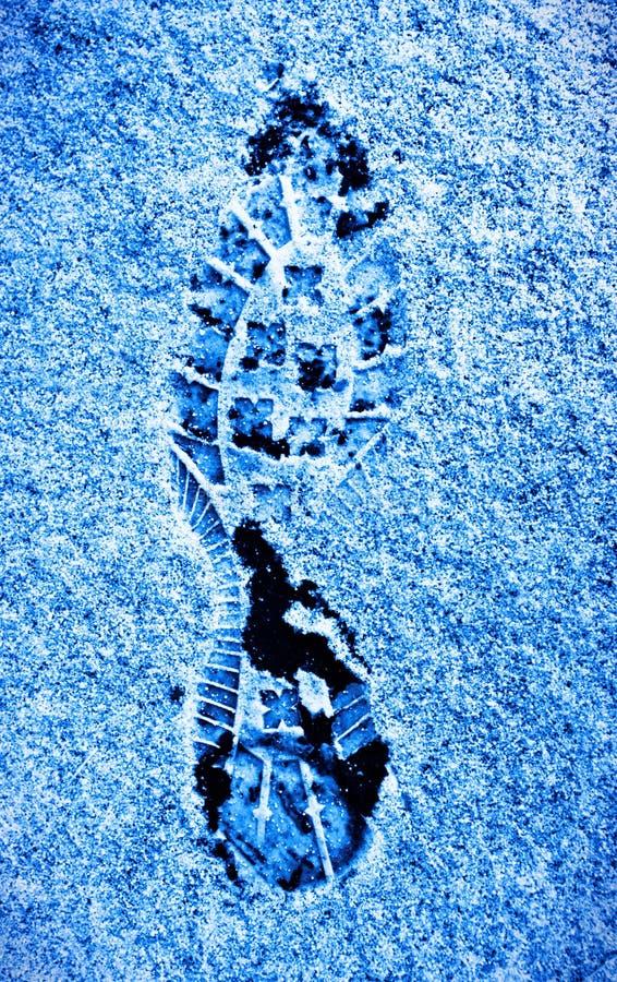 Huella humana en una nieve imagenes de archivo