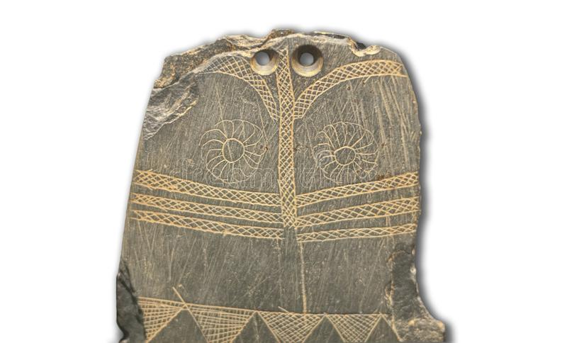 Late Neolithic engraved slate plaque, Huelva, Spain royalty free stock photography