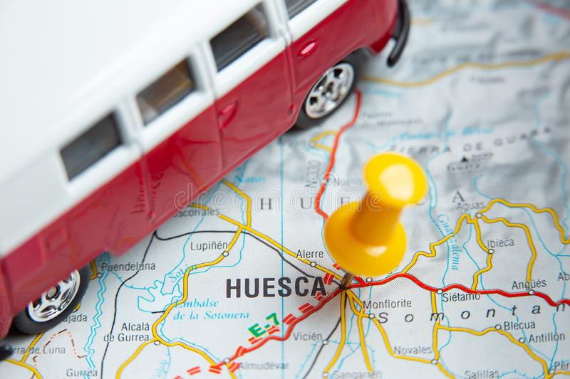 Huesca Van travel. Huesca city on the map.  a camper van traveling on the map royalty free stock photography