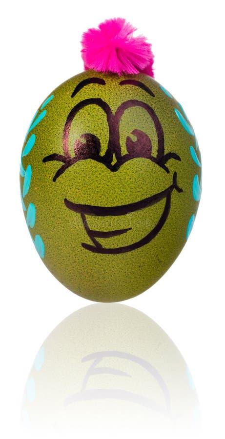 Huevo de Pascua, pintado en la cara sonriente de la historieta del individuo Adornado eg. imagenes de archivo