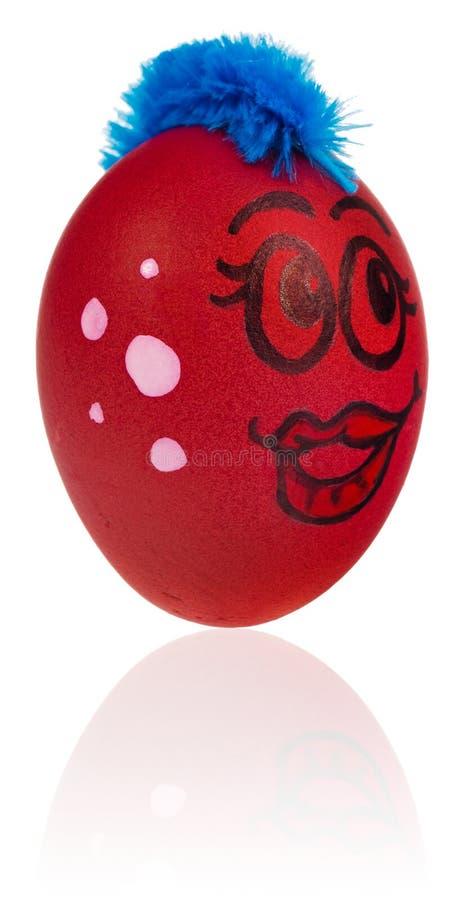 Huevo de Pascua, pintado en la cara sonriente de la historieta de la muchacha E adornada imagenes de archivo