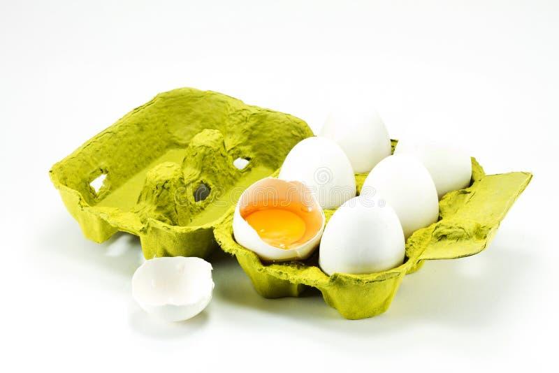 Huevo quebrado en el rectángulo imágenes de archivo libres de regalías