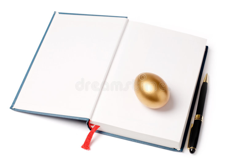 Huevo y libro de oro imágenes de archivo libres de regalías