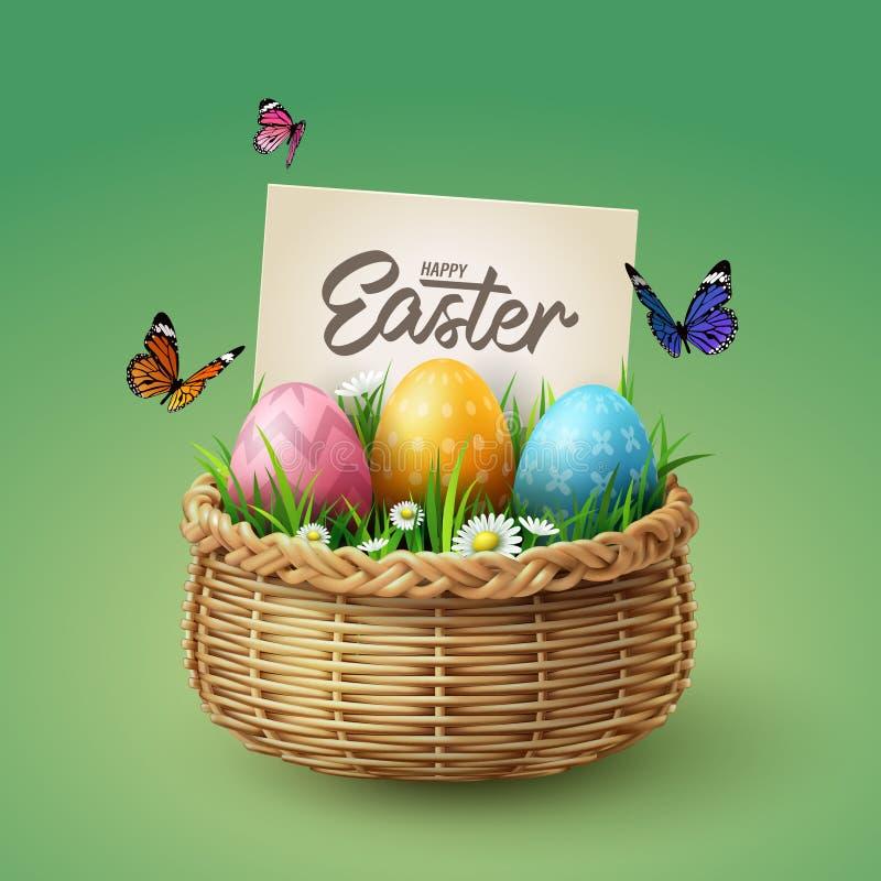 Huevos coloridos en cesta con la mariposa y la hierba con las letras felices de la mano de la caligrafía de Pascua, concepto de l foto de archivo libre de regalías