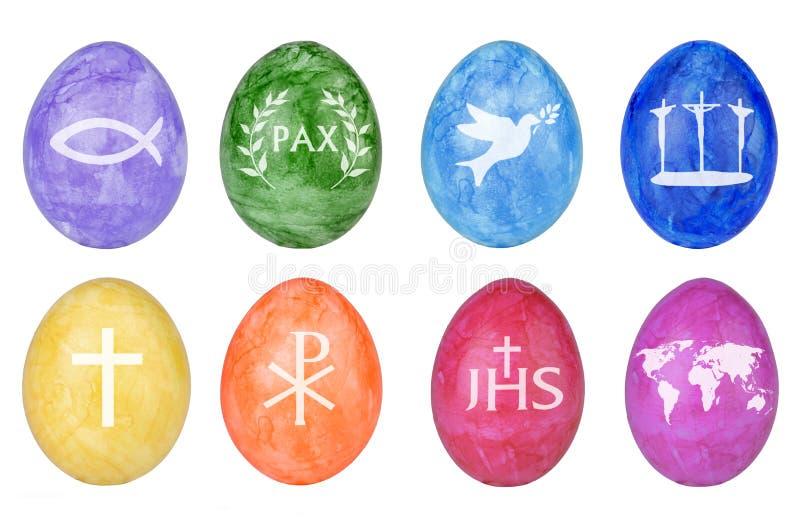 Huevos de Pascua con símbolos cristianos ilustración del vector