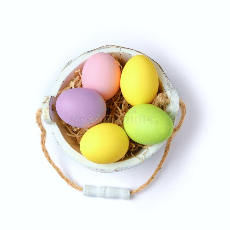 Huevos de Pascua en cubo de madera fotografía de archivo libre de regalías