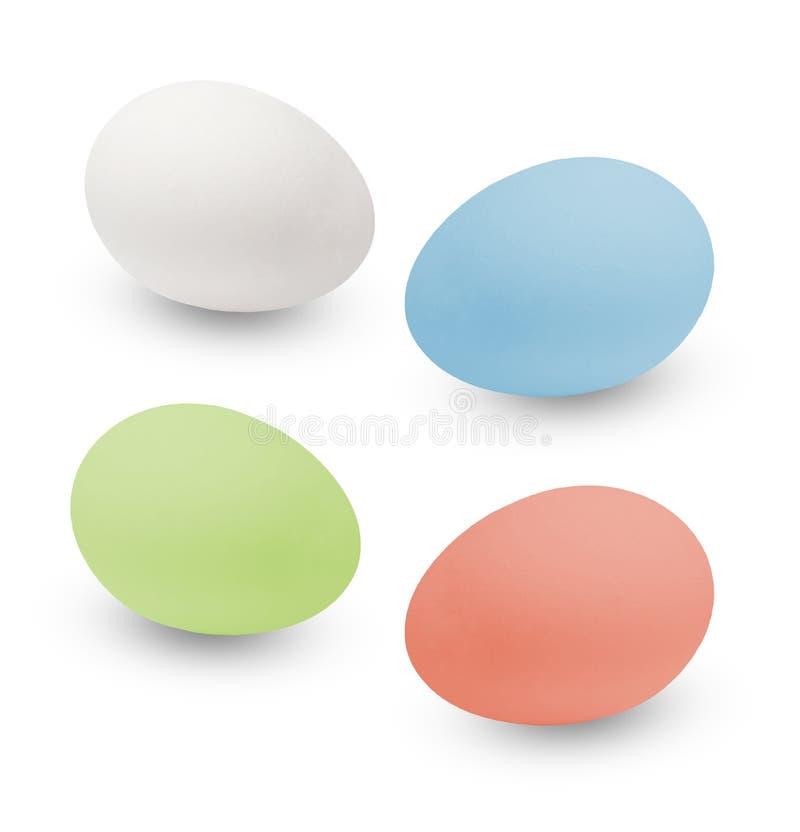 Huevos de Pascua multicolores Fondo aislado blanco Visión superior lateral foto de archivo libre de regalías