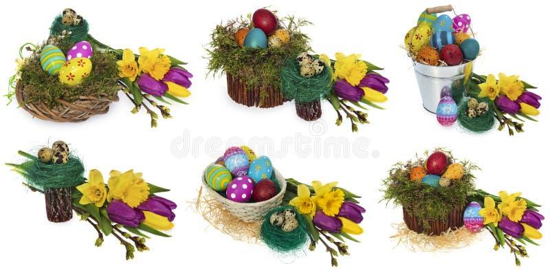 Huevos de Pascua pintados a mano en una guirnalda de mimbre, jerarquía del ` s del pájaro del musgo foto de archivo