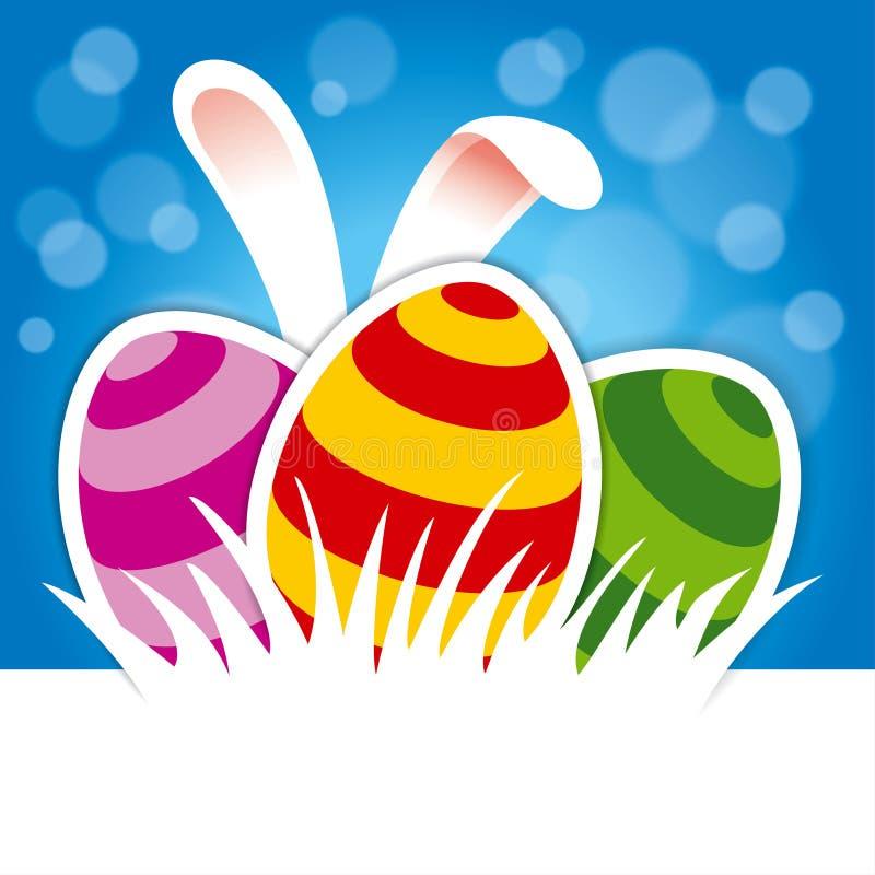 Huevos de Pascua y oídos del conejito en fondo azul fotografía de archivo libre de regalías