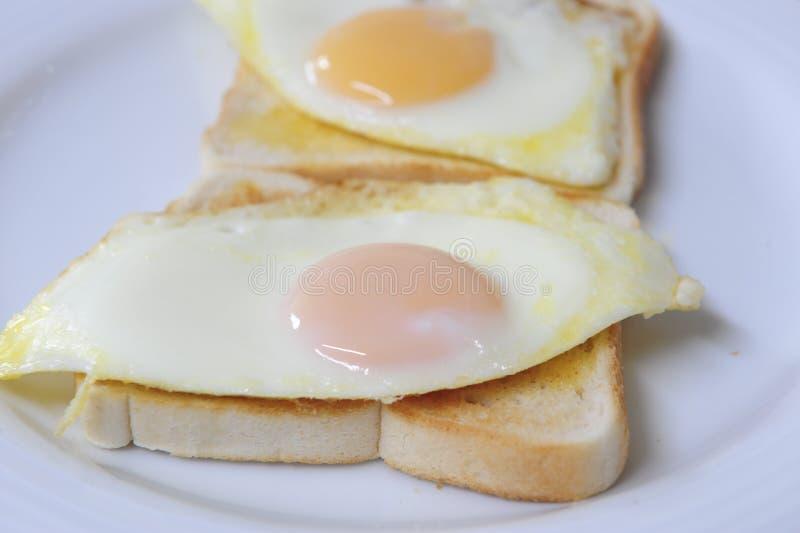 Huevos en tostada fotografía de archivo