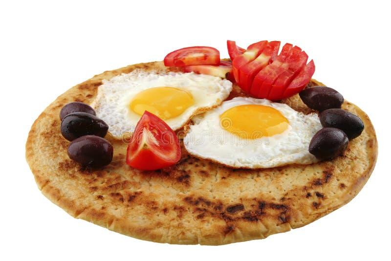 Huevos fritos en la crepe imagen de archivo