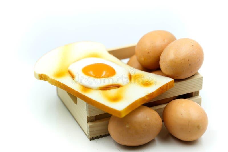 Huevos para el desayuno con la tostada foto de archivo