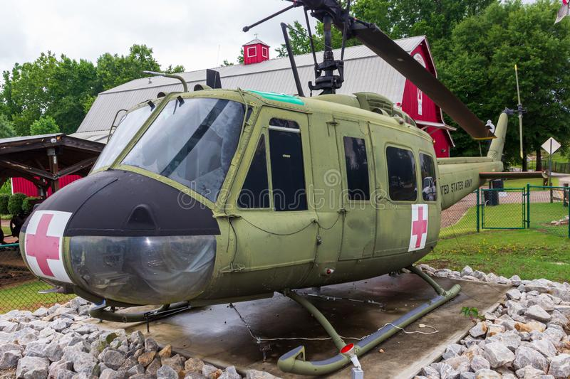 A Huey UH-1F model 205 helicopter on display outside of the Veteran`s Museum in Heritage Village at Heritage Park. stock image