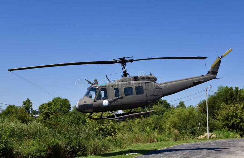 Huey Utility Helicopter. This is a Summer picture of United States Army UH-1 Huey Utility Helicopter on display in Dixon, Illinois in Lee County. This picture of stock photo