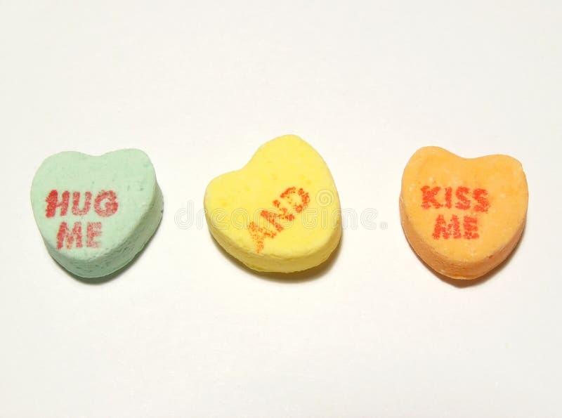 Hug me and kiss me hearts stock photography