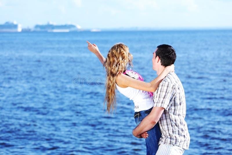Hug see on sea. Man and woman hug in the sky and sea on sea stock image