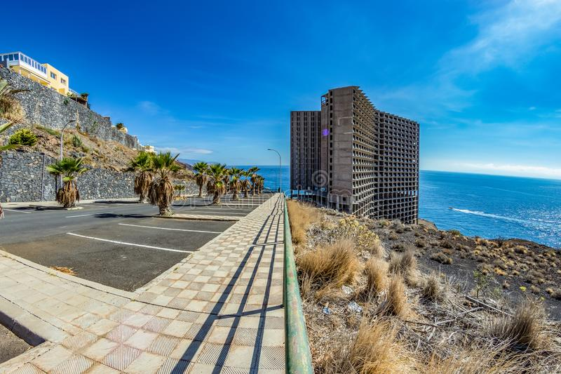 Huge Abandoned building in front of the ocean, Tenerife. Wide angle royalty free stock image