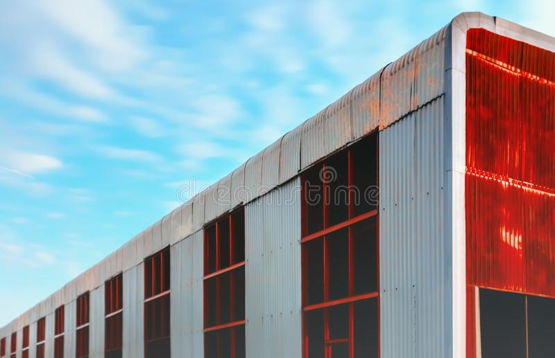 Huge Abandoned Metal Hangar Against a Blue Sky stock photos