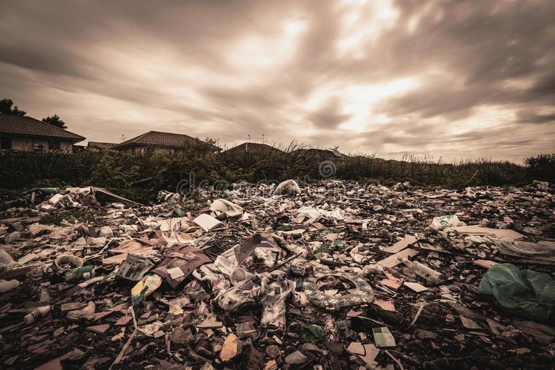 A huge amount of waste from the houses and industrial factories that were left without consciousness. Garbage dumps that cause royalty free stock photography