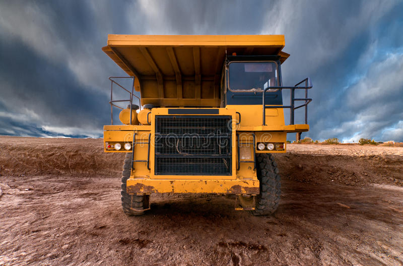 Huge auto-dump yellow mining truck stock images