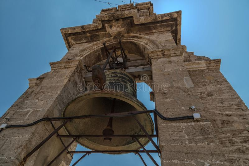 The huge bell on the roof of bell tower Torre del Micalet of the Metropolitan Cathedral Basilica of the Assumption of Our Lady o. F Valencia Saint Mary`s royalty free stock photo