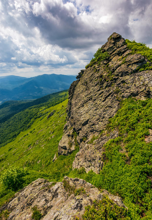 Huge boulder on the edge of a hill stock images