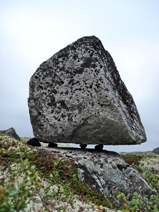 Huge boulders Seida on tiny stone legs are taken by many as places of sacrifice and rites of the ancient Sami. stock image