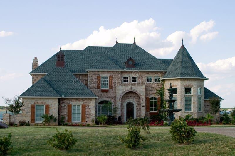Huge Brick House on Lake royalty free stock images