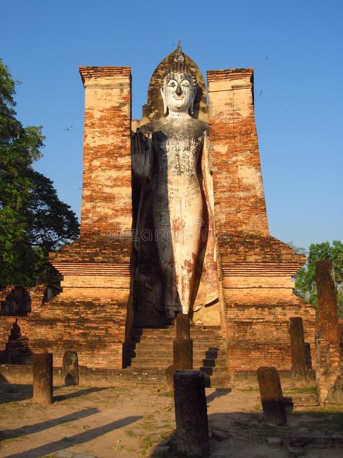Huge Buddha statue Sukhothai Historical Park in Thailand stock photography