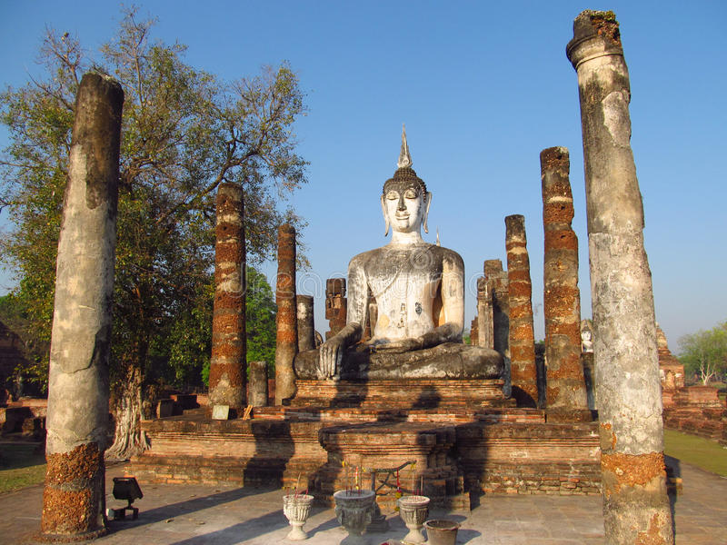 Huge Buddha statue Sukhothai Historical Park in Thailand. Temple ruins and stone Buddha statues in Sukhothai Historical Park in Thailand, ancient capital of the royalty free stock images