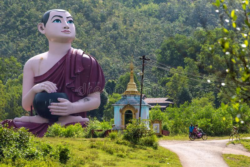 Huge burmese monk statue near the statue Win Sein Taw Ya in Kyauktalon Taung, near Mawlamyine, Myanmar. Huge burmese monk statue near the statue Win Sein Taw Ya royalty free stock image