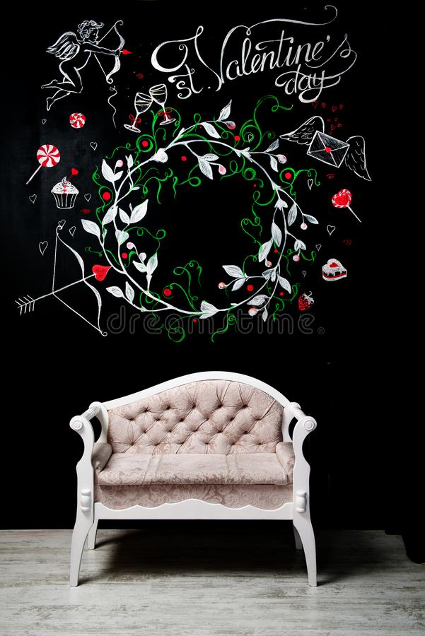Huge chalk board with a painted wreath stock image