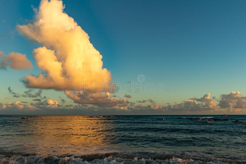 Huge cloud cumulus nimbus over the sea during sunset. Water calm. Vacation landscape stock images
