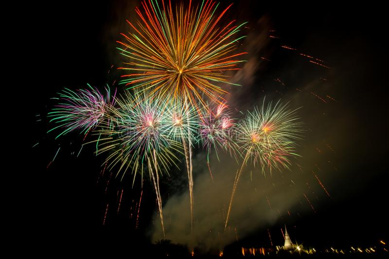Huge, colorful fireworks over the rice fields at dusk. Firework at night stock photography