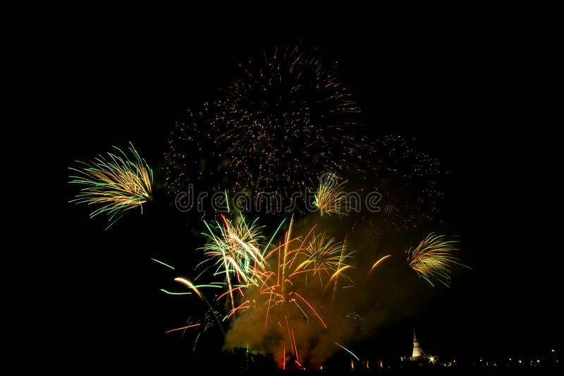 Huge, colorful fireworks over the rice fields at dusk. Firework at night royalty free stock photos