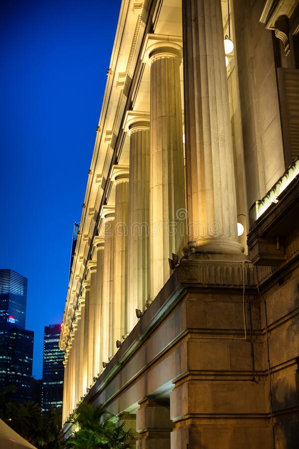 Huge columns at the rear of the Fullerton Hotel royalty free stock images