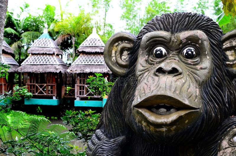 Huge concrete carved monkey statue in an Asian aquatic jungle theme park stock photography