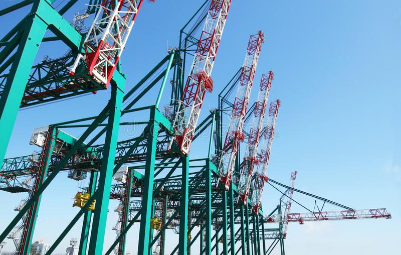 Huge container handling gantry cranes at a container terminal. Blue sky royalty free stock images