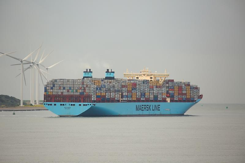 Huge Container Ship. ROTTERDAM, THE NETHERLANDS - SEPTEMBER 22: Maersk Triple E class container ship leving the Port of Rotterdam, 22th of September, 2015. It's royalty free stock photos