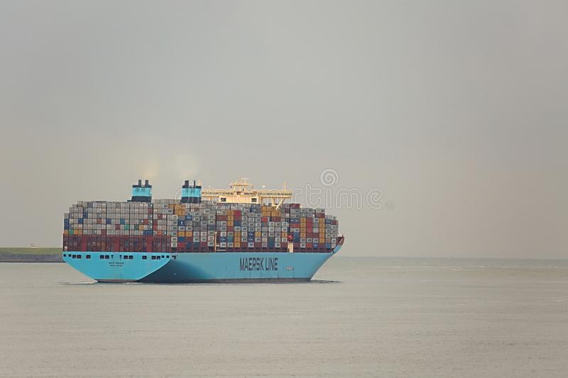 Huge Container Ship. ROTTERDAM, THE NETHERLANDS - SEPTEMBER 22: Maersk Triple E class container ship leving the Port of Rotterdam, 22th of September, 2015. It`s royalty free stock photos