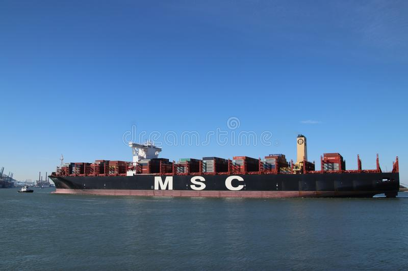 Huge container vessel MSC Ditte is arriving from sea to the container terminal Maasvlakte stock photo