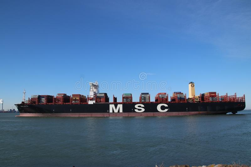 Huge container vessel MSC Ditte is arriving from sea to the container terminal Maasvlakte stock image